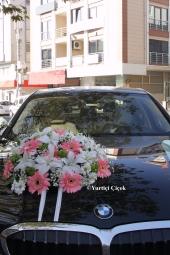 Canlı Mor Orkide ve Beyaz Güllerin Harika Tasarımı ile Sevdiklerinize Unutulmaz Bir Sürpriz Yapabilirsiniz.